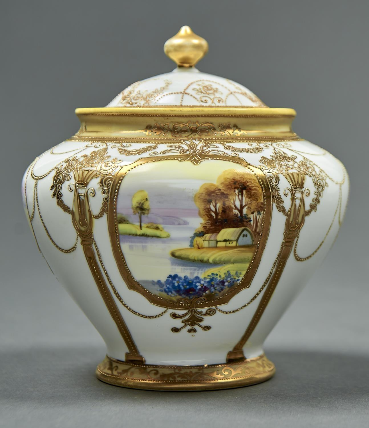 A NORITAKE VASE AND COVER, EARLY 20TH C, THE VASE PAINTED WITH FOUR RURAL LANDSCAPE MEDALLIONS