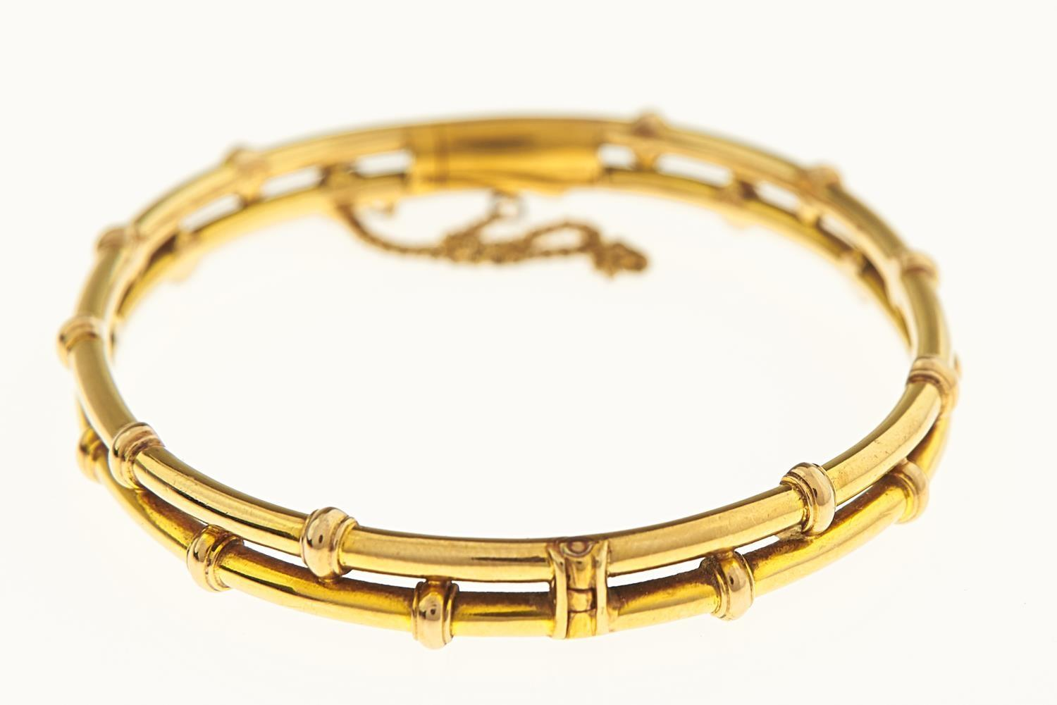 A GOLD BAMBOO FORM BANGLE, EARLY 20TH C, 64MM, MARKED 18CT, 14G Good condition