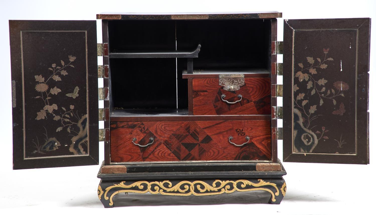 A JAPANESE ELM CABINET, LATE 19TH C, THE ROUNDED RECTANGULAR TOP WITH APPLIED ENGRAVED COPPER CLASPS - Image 2 of 2