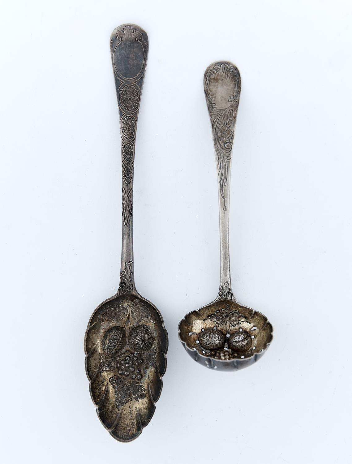 A GEORGE III SILVER TABLESPOON AND SAUCE LADLE, LATER CHASED AND GILT AS BERRY SPOONS, BY