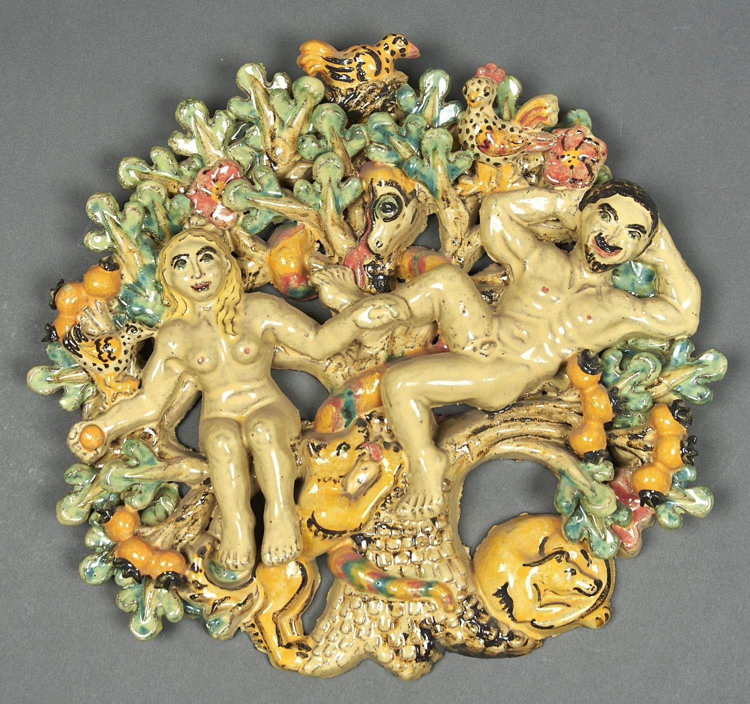 STUDIO POTTERY. A POLYCHROME GLAZED TERRACOTTA ADAM AND EVE WALL PLAQUE BY CATHERINE ROOKE, WITH