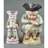 A CONTINENTAL POTTERY SNUFF TAKER TOBY JUG AND A SMALLER FRENCH FAIENCE TOBY JUG, LATE 19TH /