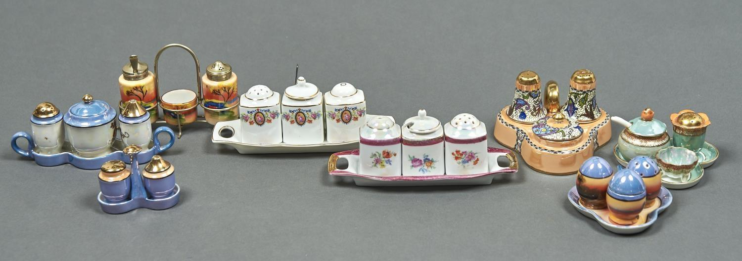 TWO NORITAKE AND SIX OTHER JAPANESE PORCELAIN CONDIMENT SETS, EARLY 20TH C, VARIOUSLY DECORATED,