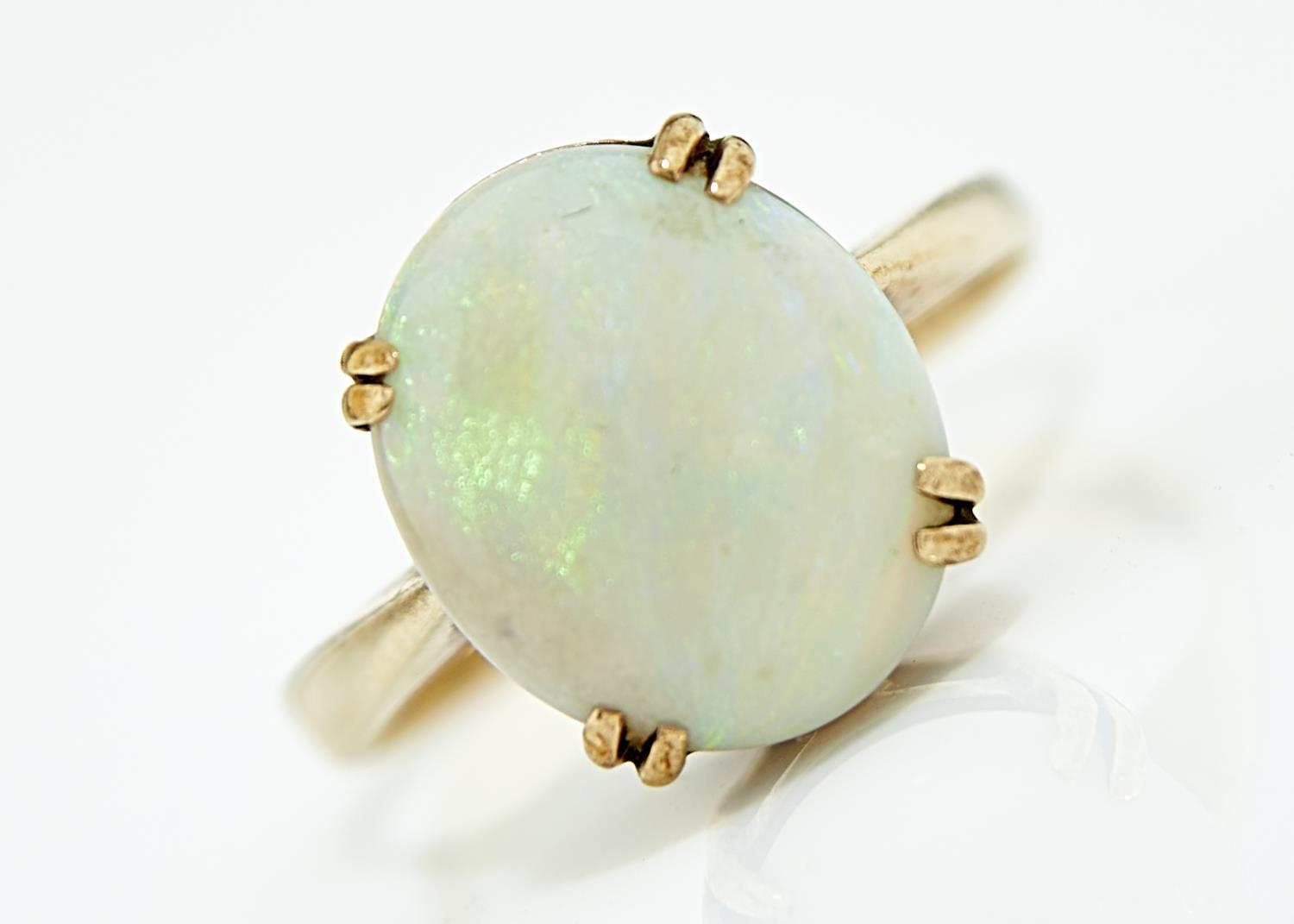 AN OPAL RING, THE CABOCHON 11 X 13MM, IN 9CT GOLD, EDINBOROUGH 1978, 4G, SIZE O Opal of good