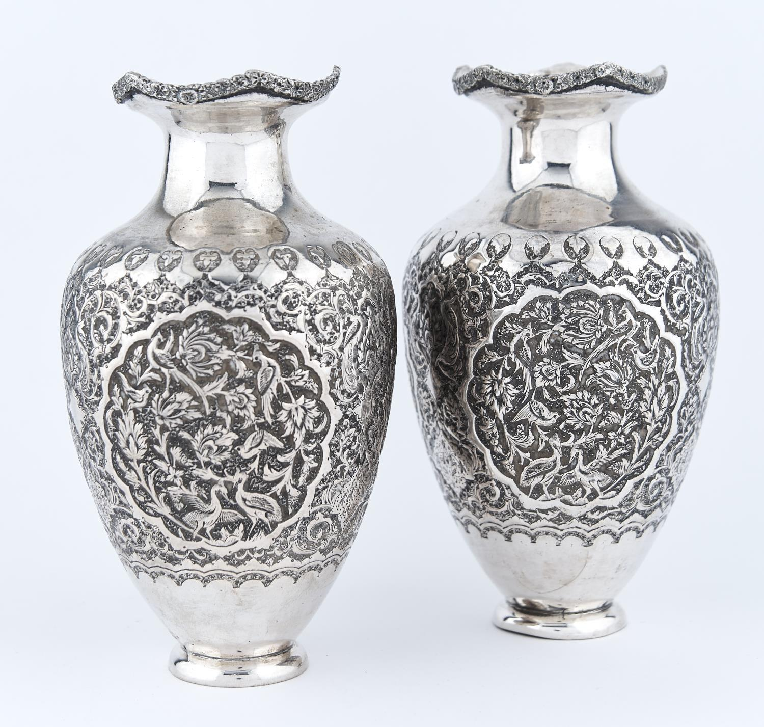 A PAIR OF OTTOMAN SILVER SHOULDERED OVIFORM REPOUSSE VASES, ARMENIA, LATE 19TH C, THE SHAPED NECK