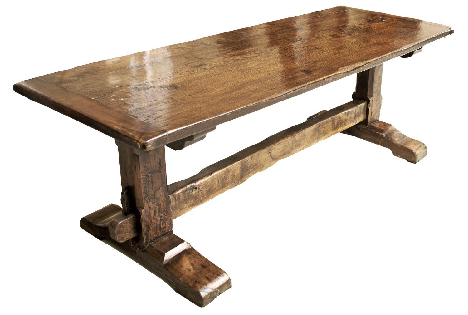 A REPRODUCTION OAK REFECTORY TABLE IN MID 17TH C STYLE, THE CLEATED PLANK TOP ABOVE CHAMFERED SQUARE