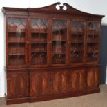 A REPRODUCTION MAHOGANY BREAKFRONT BOOKCASE IN GEORGE III STYLE, MODERN, BROKEN SWAN NECK PEDIMENT