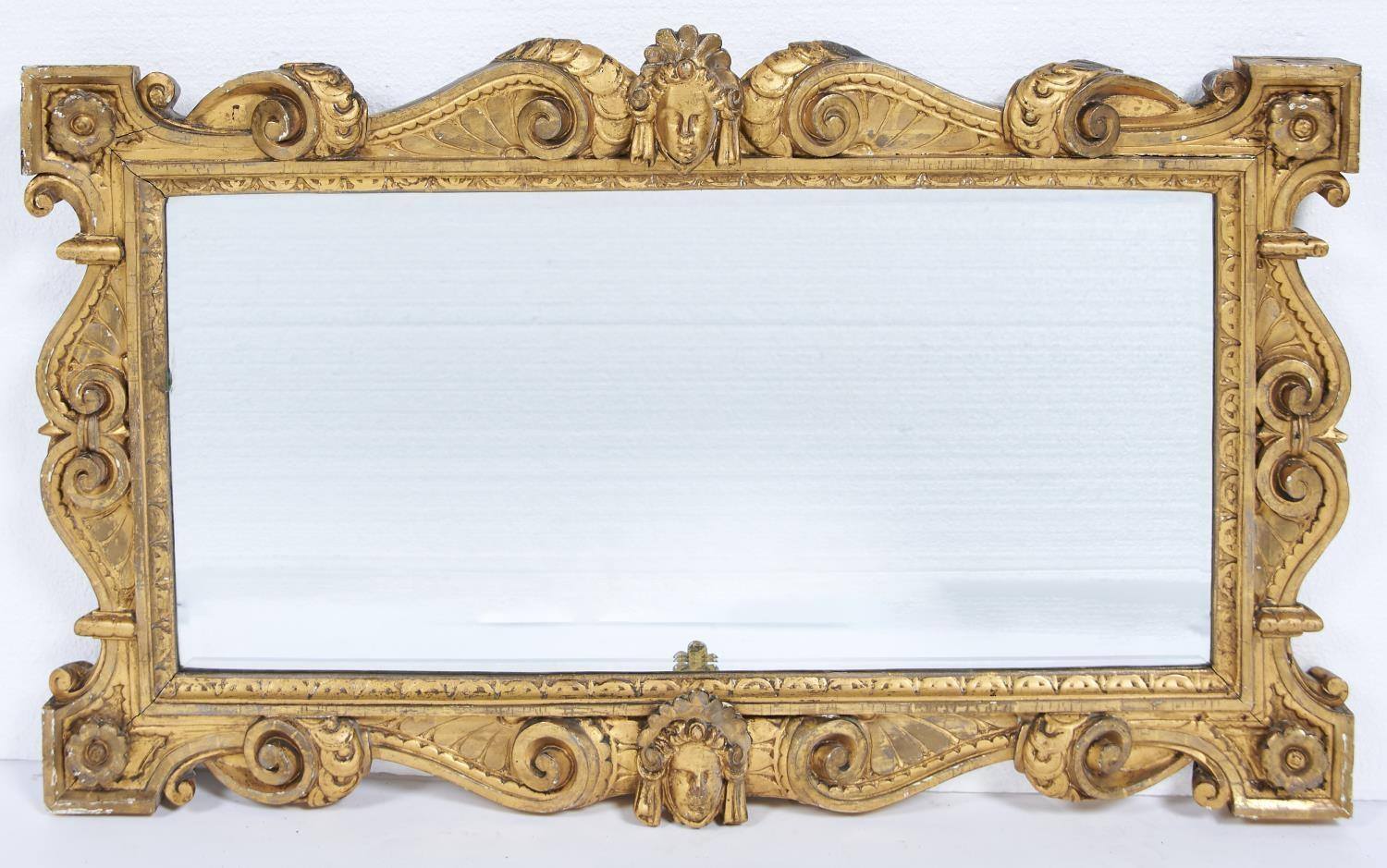 A VICTORIAN GILTWOOD MIRROR, KENTIAN STYLE, 19TH C, THE FRAME CARVED WITH C AND S SCROLLS CENTRED BY