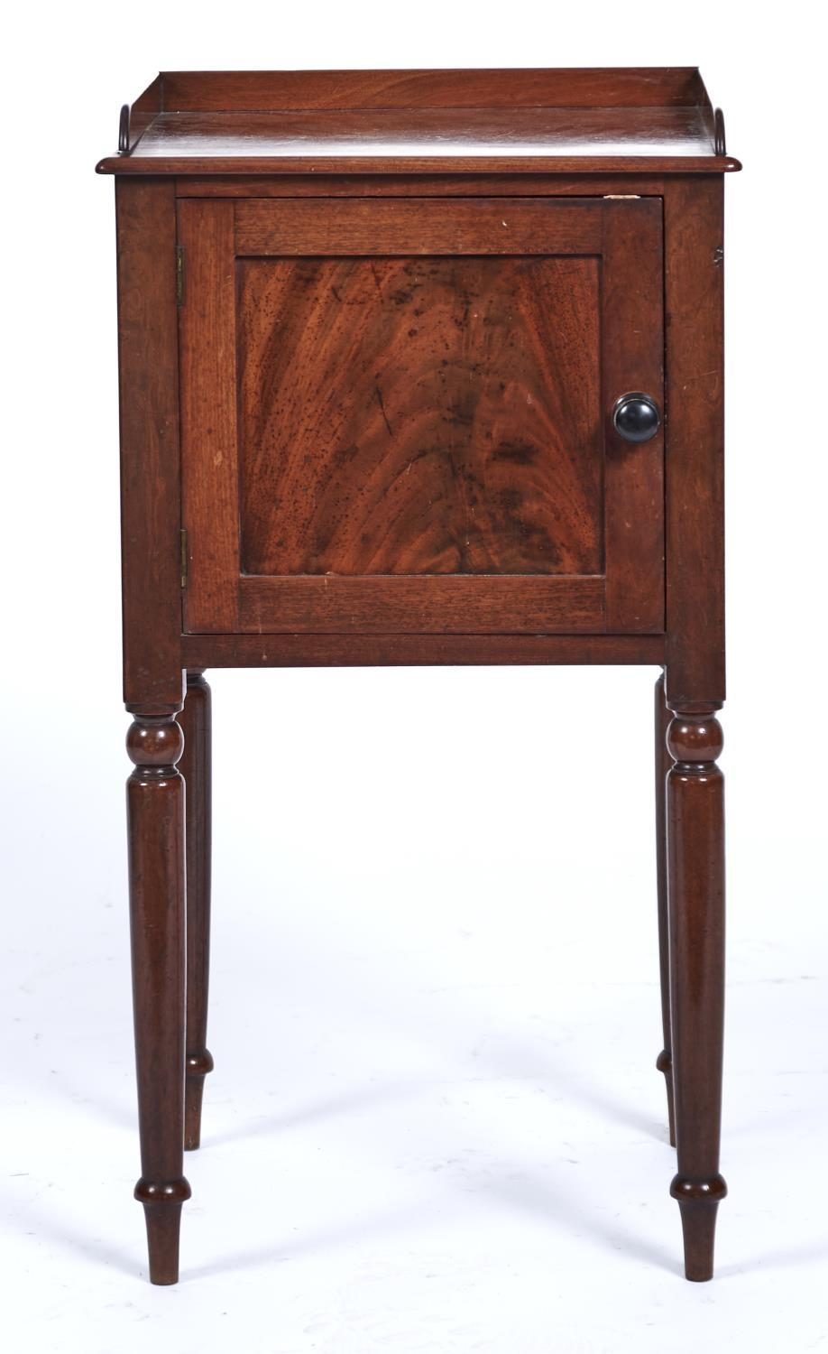 A VICTORIAN MAHOGANY NIGHT CUPBOARD, C1860, THE FIGURED TOP WITH THREE QUARTER GALLERY ABOVE A