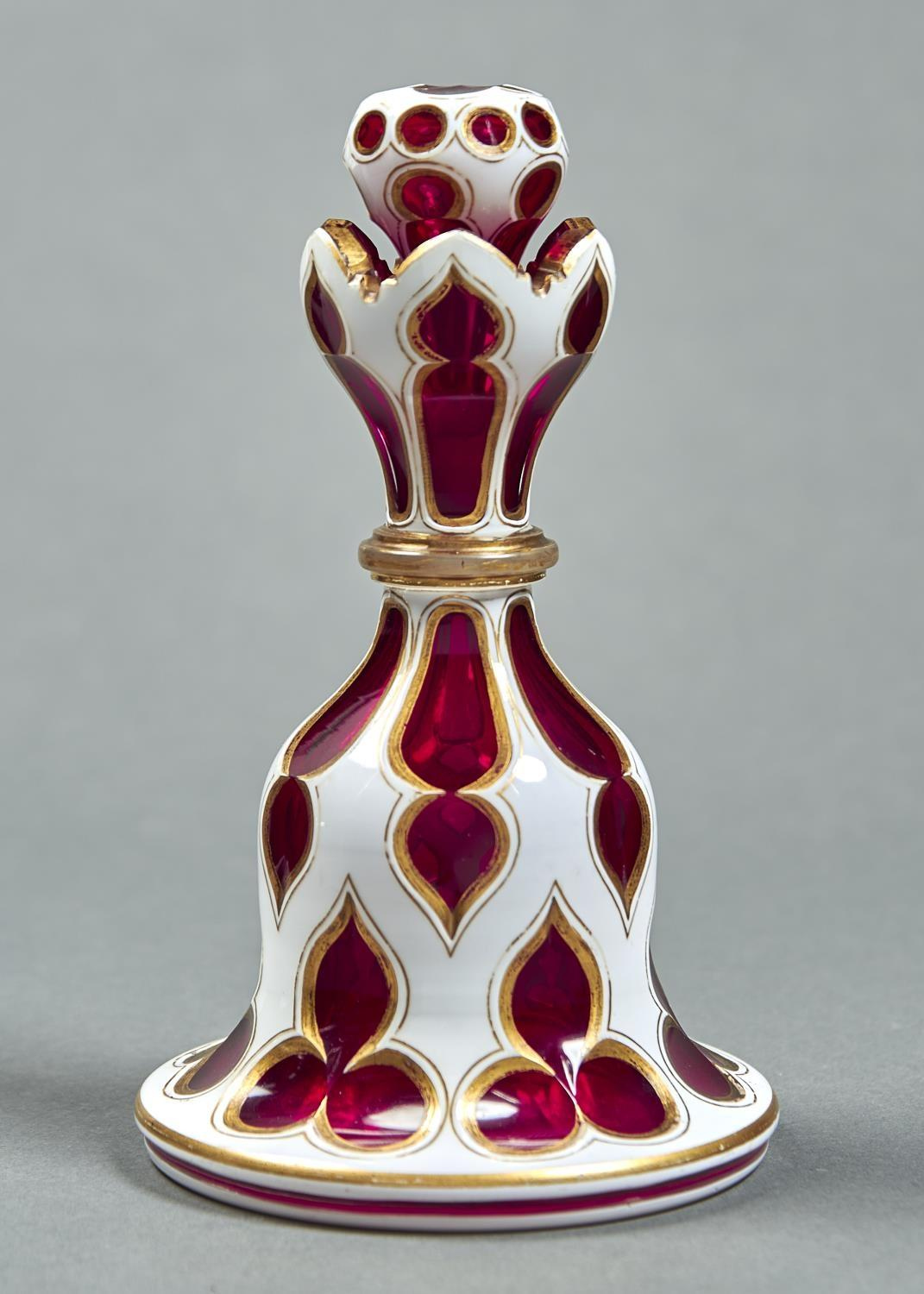 A CASED GLASS SCENT BOTTLE AND STOPPER, MID 19TH C, OF RUBY GLASS CASED IN WHITE AND GILT, BELL