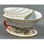 A VICTORIAN STAFFORDSHIRE SHELL SHAPED SPOON WARMER ON  OVAL BASE MOULDED AND DECORATED WITH