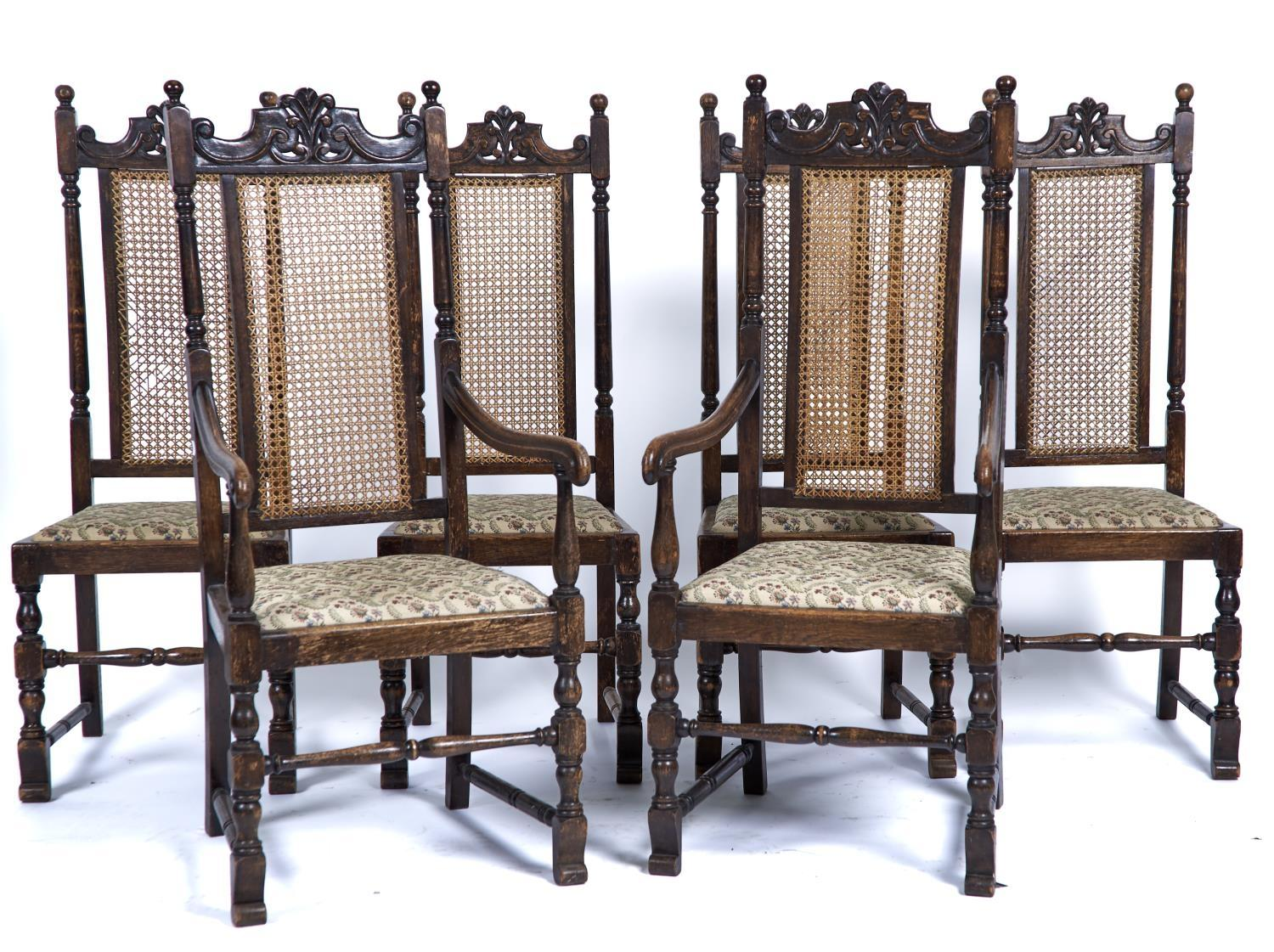 A SET OF SIX OAK DINING CHAIRS, C1930'S, FOLIATE CARVED TOP RAILS ABOVE CANED VERTICAL PANELS