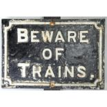 RAILWAYANA. BEWARE OF TRAINS, CAST IRON NOTICE, EARLY 20TH C, 37.5 X 25.5CM Cracked, affixed to part