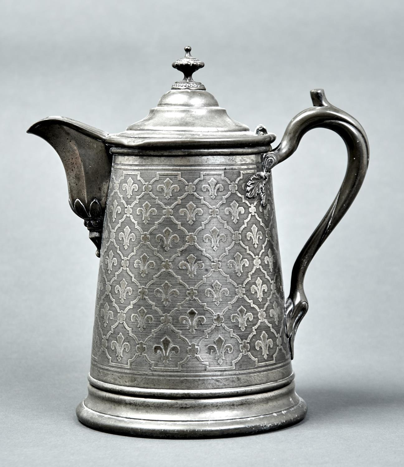 A VICTORIAN BRITANNIA METAL FLAGON, C1880, THE HANDLE ISSUING FROM APPLIED OAK LEAVES, 30CM H