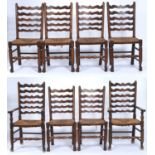 A SET OF EIGHT ASH LADDER BACK DINING CHAIRS WITH GRADUATED WAVY HORIZONTAL RAILS, RUSH SEATS ON
