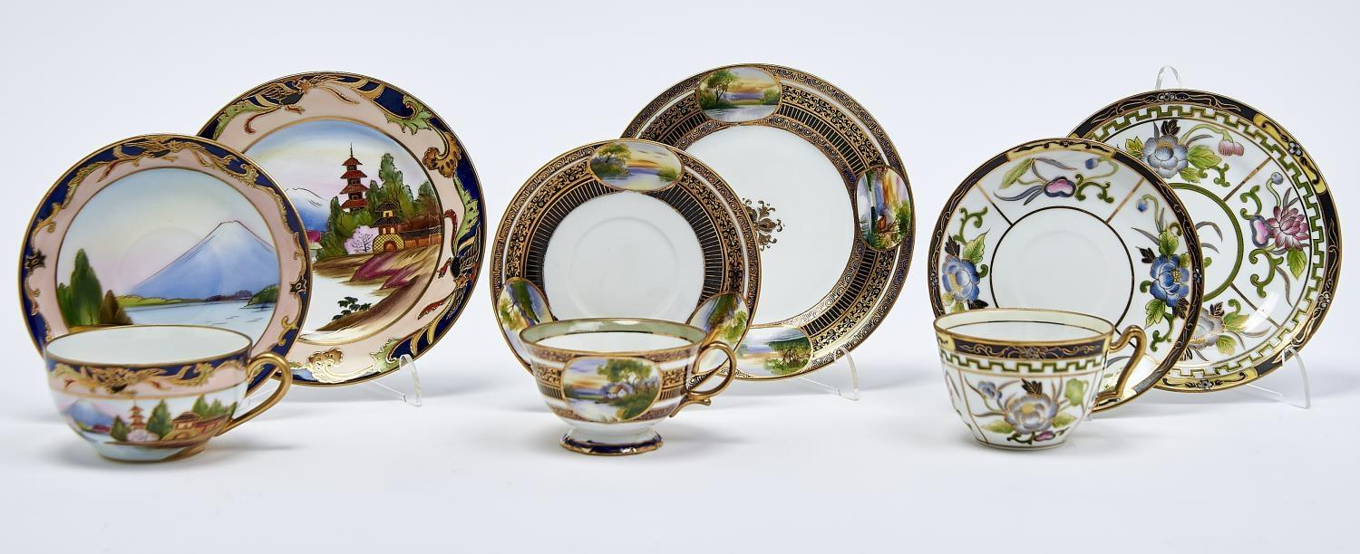 THREE NORITAKE TEACUPS, SAUCERS AND SIDE PLATES, EARLY 20TH C, PAINTED WITH LANDSCAPES OR