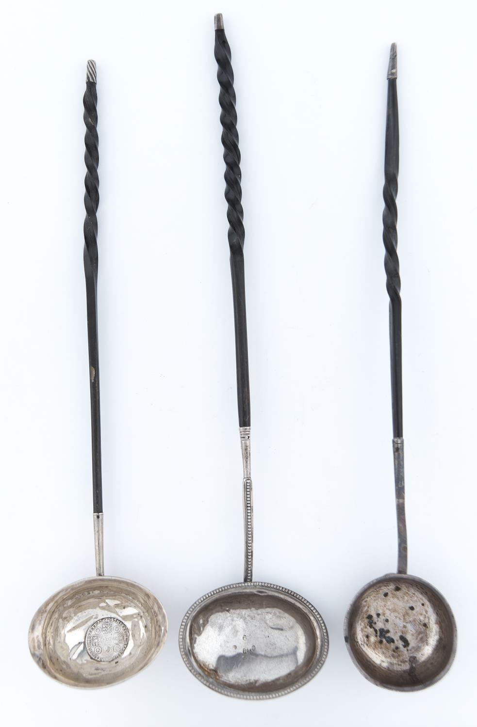 THREE SILVER PUNCH LADLES WITH TWISTED BALEEN HANDLE Wear and dents, handles undamaged