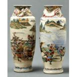 A PAIR OF JAPANESE SATSUMA VASES, MEIJI PERIOD, ENAMELLED WITH SAMURAI IN A CONTINUOUS LANDSCAPE,