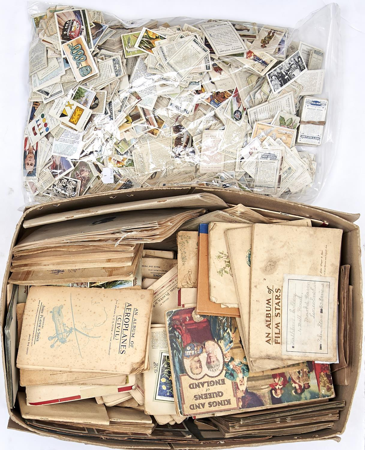 AN EXTENSIVE COLLECTION OF CIGARETTE CARDS, TO INCLUDE MULTIPLE ALBUMS WITH CARDS ATTACHED WITH