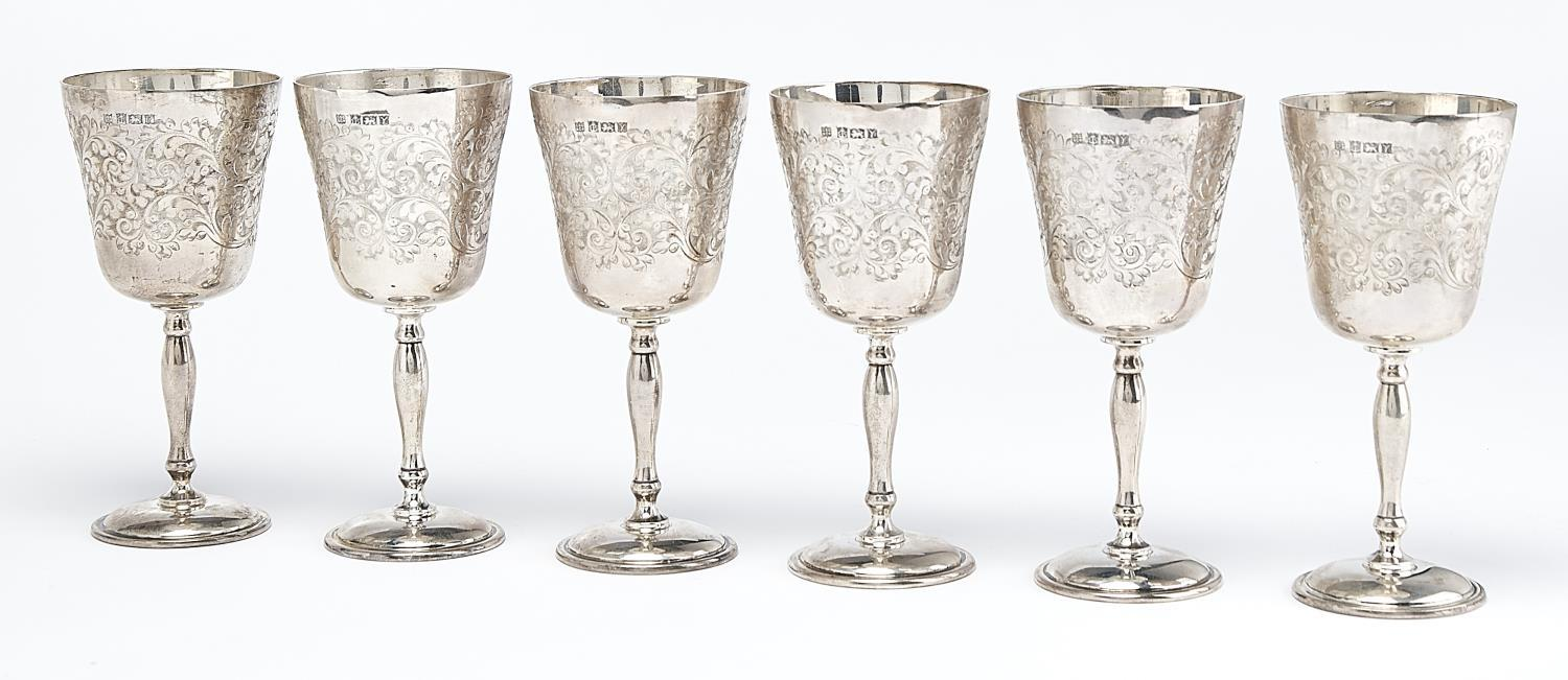A SET OF SIX ELIZABETH II  SILVER GOBLETS, THE ROUNDED FUNNEL BOWL FOLIATE ENGRAVED AROUND A