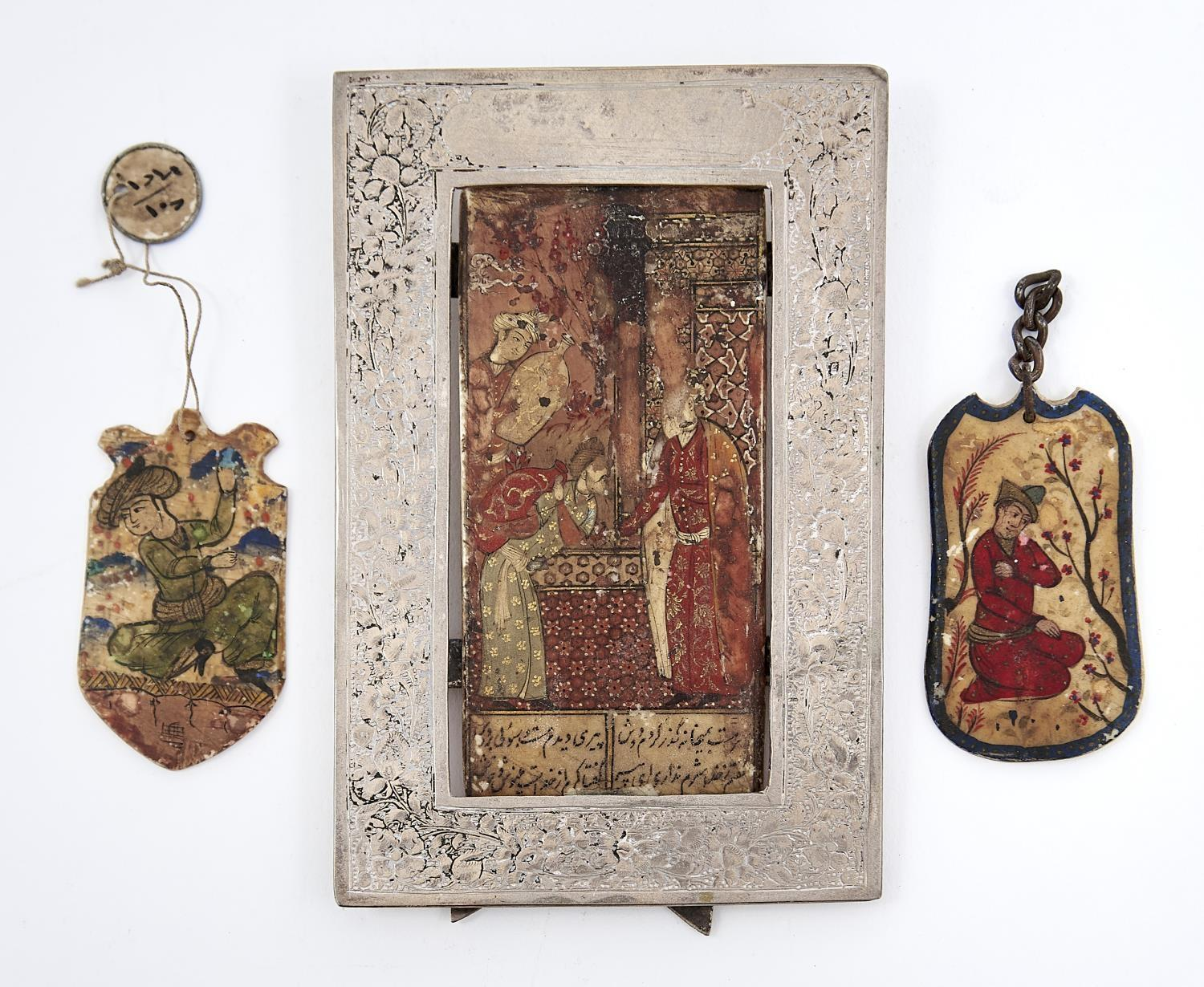 THREE MUGHAL MINIATURE POLYCHROME BONE AMULETS AND A TABLET, 19TH/20TH C, ONE WITH INSCRIPTION, 90 X