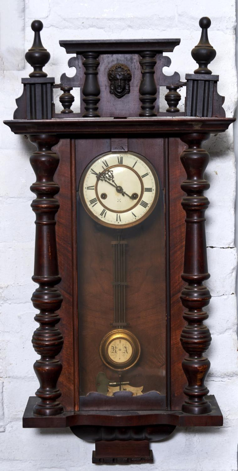 A WALNUT VIENNA WALL CLOCK, C1890, THE PEDIMENT WITH SPLIT PILLARS, MASK AND BALL AND SPIRE FINIALS,