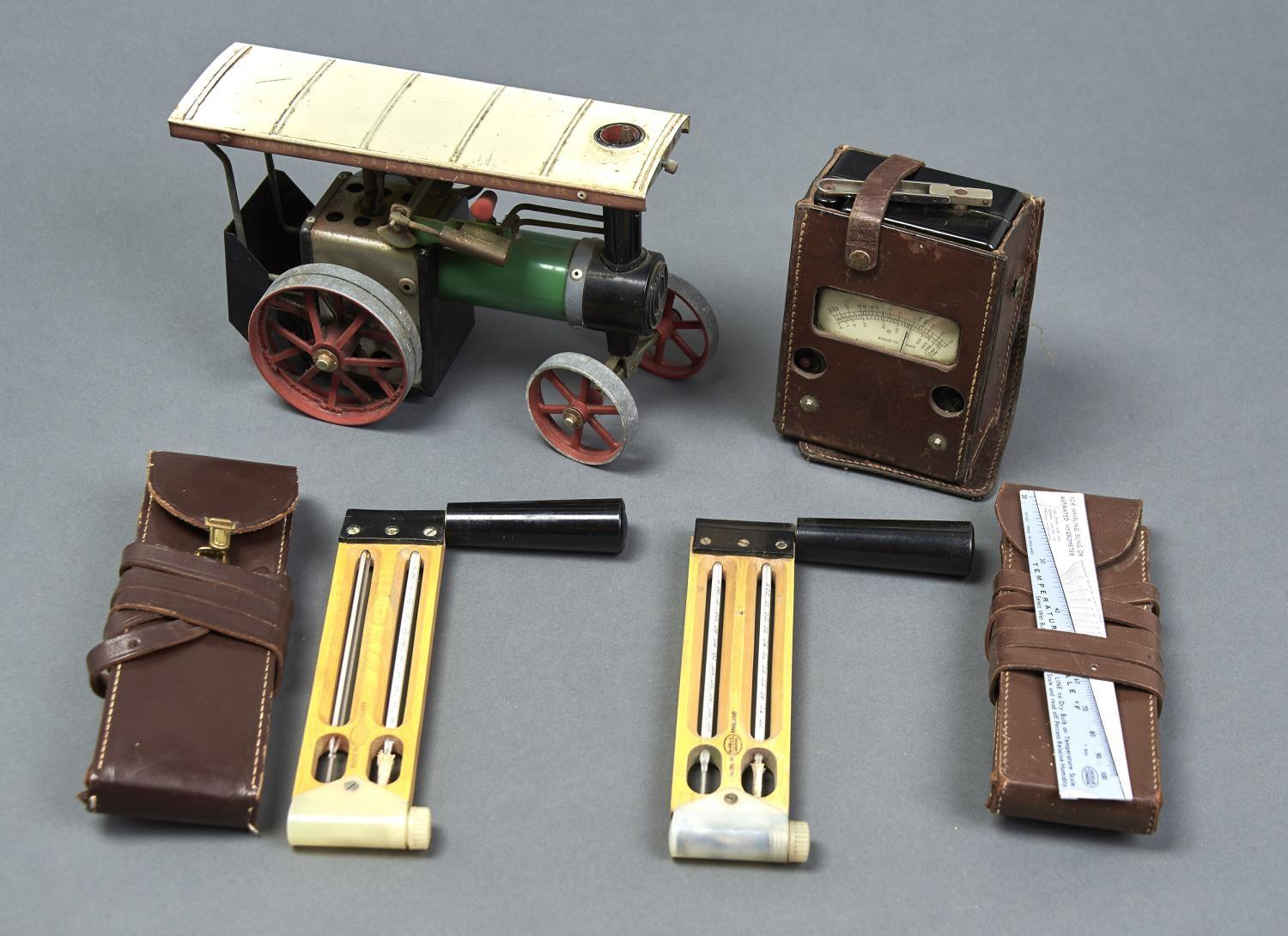 A MAMOD TRACTION ENGINE, VOLTAGE TESTER, TEMPERATURE TOOLS AND SLIDE RULE