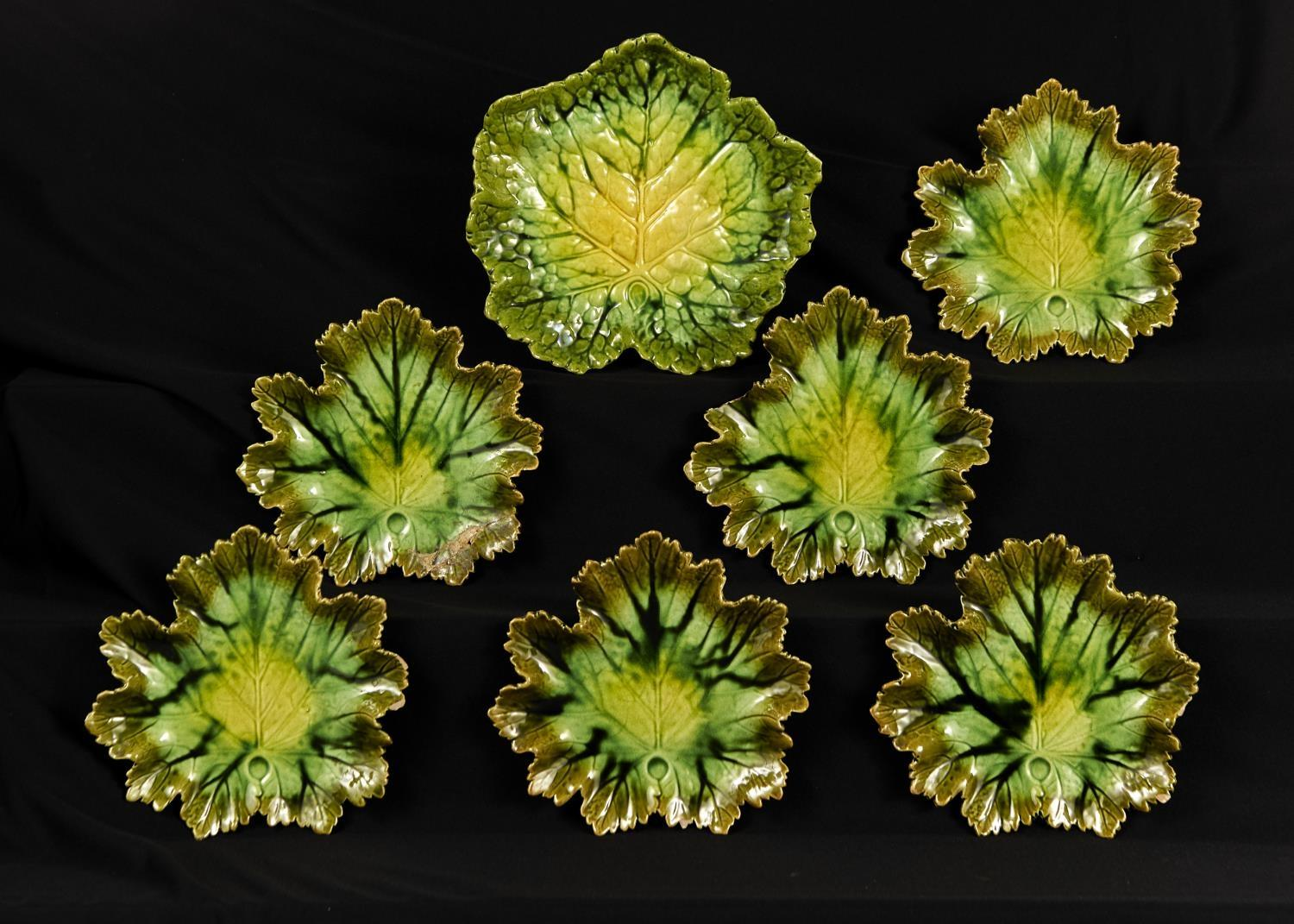 A BRETBY LEAF SHAPED MAJOLICA DESSERT SERVICE, C1900, COMPRISING SIX PLATES AND A STAND ON RED