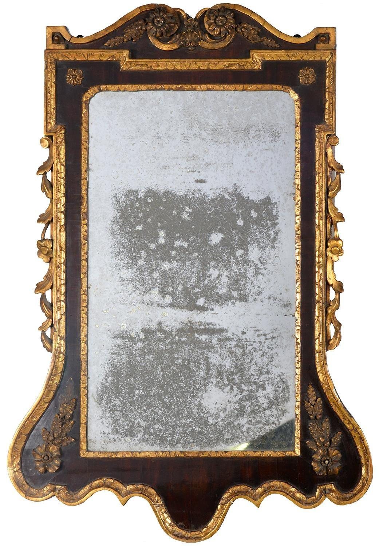A VICTORIAN PARCEL GILT WALNUT MIRROR, C1870, IN GEORGE II STYLE, 103CM H, 69.5CM WProvenance: The