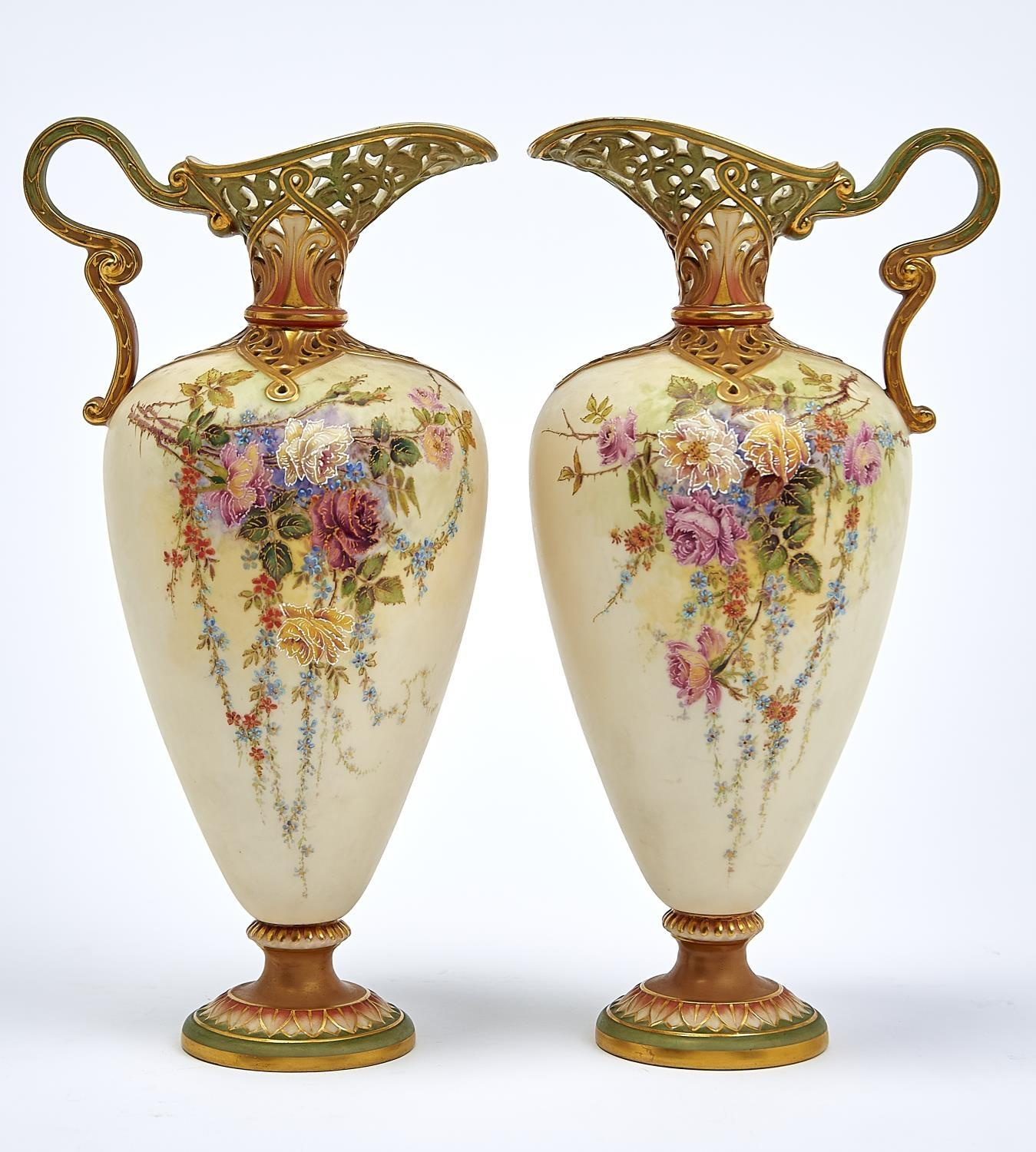 A PAIR OF GRAINGER WORCESTER EWERS WITH PIERCED SHOULDER AND NECK, 1890, DECORATED WITH ROSES, THE