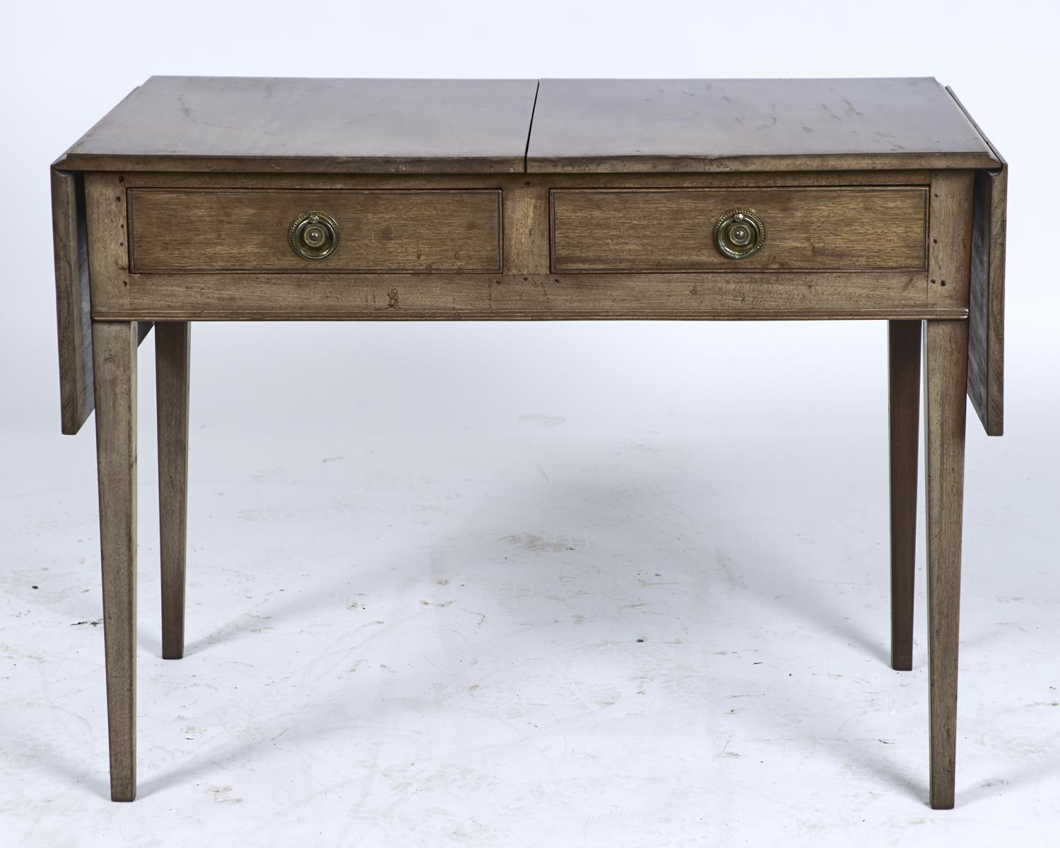 A MAHOGANY TWO DRAWER TABLE, THE RECTANGULAR TOP WITH PAIR OF FOLDING FLAPS, SCRATCH MOULDED DRAWERS