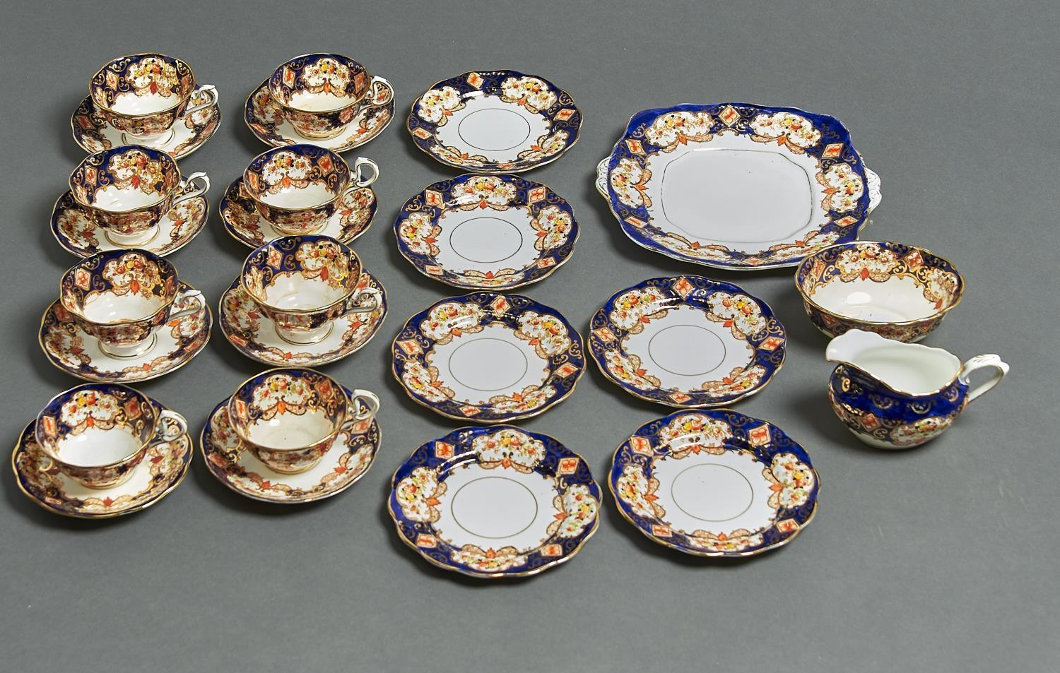 A ROYAL ALBERT HEIRLOOM TEA SERVICE, PRINTED AND PAINTED WITH FLOWERS AND LEAFAGE WITHIN GILT FRAMES