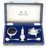 AN ELIZABETH II THREE PIECE SILVER CONDIMENT SET, BLUE GLASS LINERS, PEPPERETTE 80MM H, BY