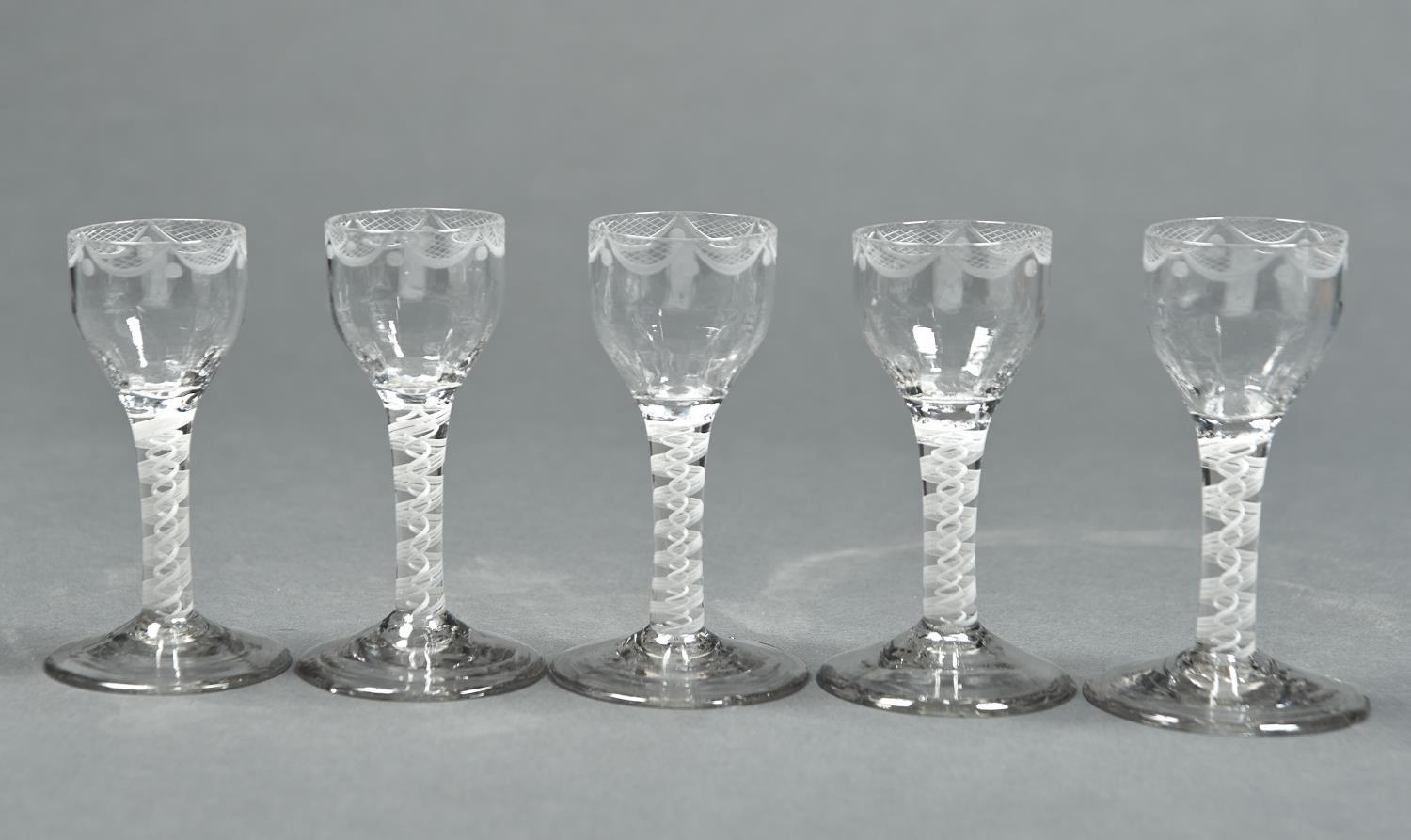 A SET OF FIVE WINE GLASSES, 19TH C, THE FLUTED OGEE BOWL WITH FESTOON ENGRAVED BORDER ON DOUBLE