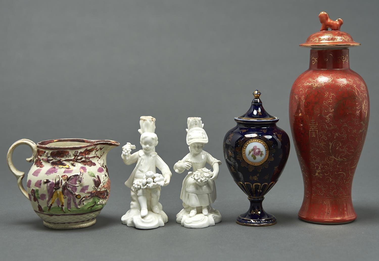 A PAIR OF SAMPSON HANCOCK GLAZED PORCELAIN CANDLESTICK FIGURES OF BOY AND GILT FLOWER SELLERS,