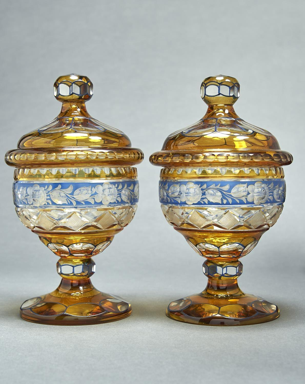 A PAIR OF BOHEMIAN CUT AND BLUE AND AMBER FLASHED GLASS SWEETMEAT JARS AND COVERS, EARLY 20TH C, THE