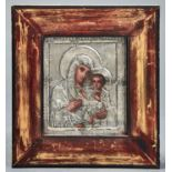 A RUSSIAN ICON OF MARY AND THE CHRIST CHILD IN SILVER FRAME, ENGRAVED AND WRIGGLEWORK DECORATED