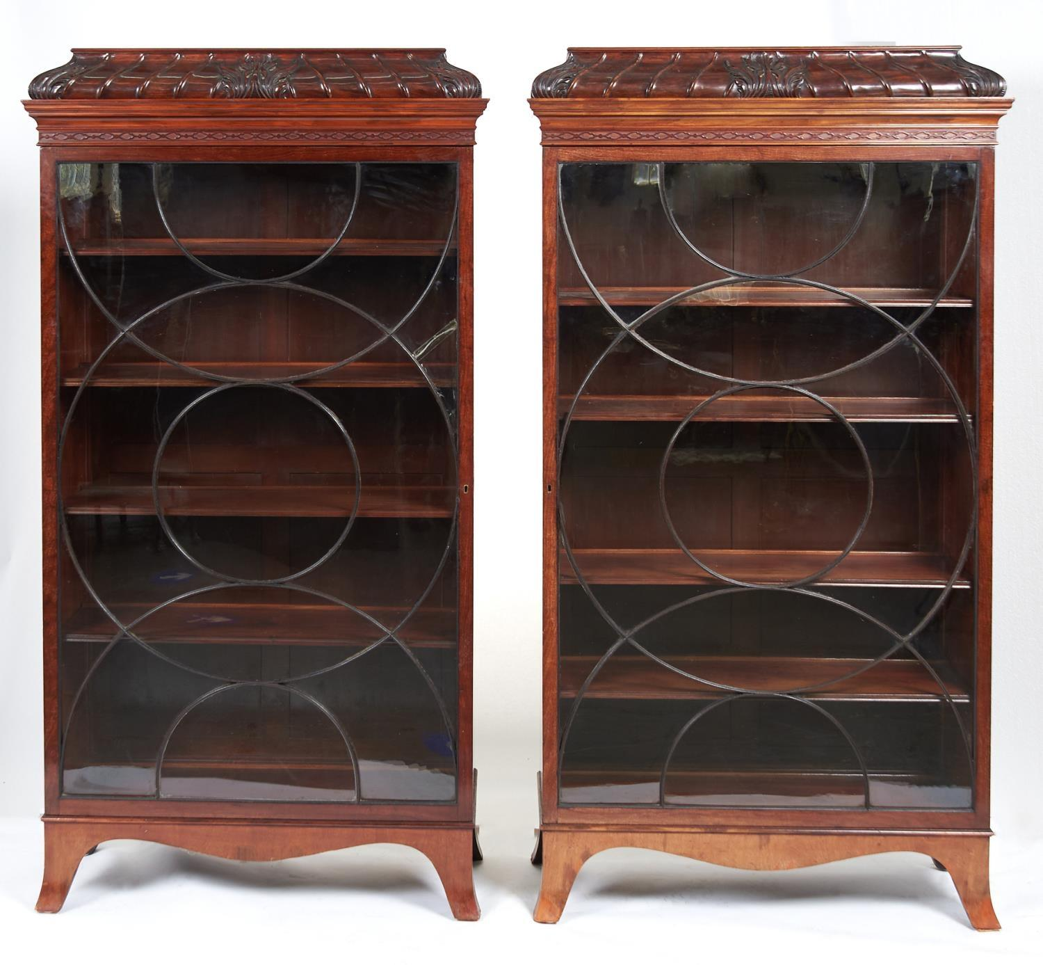 A PAIR OF ENGLISH MAHOGANY CHINA CABINETS, EARLY 20TH C, THE FLAP TOPPED CARVED BOMBE PEDIMENT