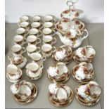 A ROYAL ALBERT OLD COUNTRY ROSES PATTERN TEA SERVICE, COMPRISING FOURTEEN CUPS AND SAUCERS, AND SIDE