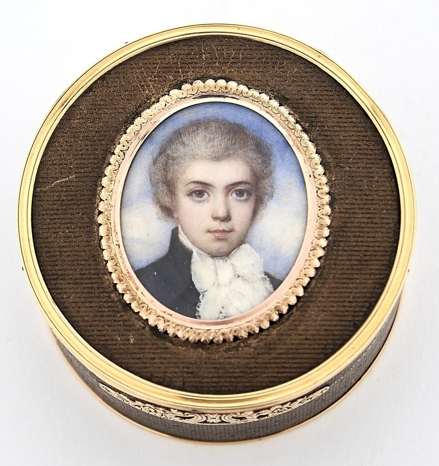 A LOUIS XVI GOLD MOUNTED COMPOSITION BOITE-A-MINIATURE, THE BLACK AND GOLD DECORATED BOX INSET WITH