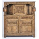 A REPRODUCTION OAK COURT CUPBOARD, CONVENTIONAL FORM WITH FOLIATE CARVED FRIEZE ABOVE CUPBOARD