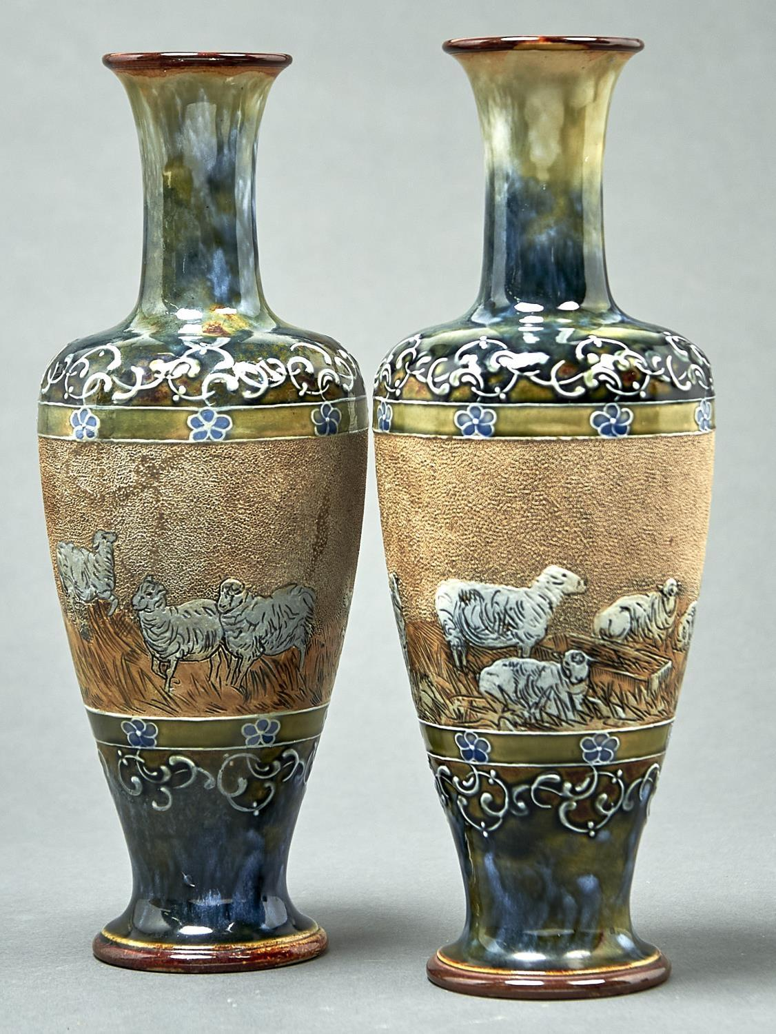 A PAIR OF DOULTON WARE VASES, C1891-1913, OF SHOULDERED FORM DECORATED BY HANNAH B. BARLOW WITH A