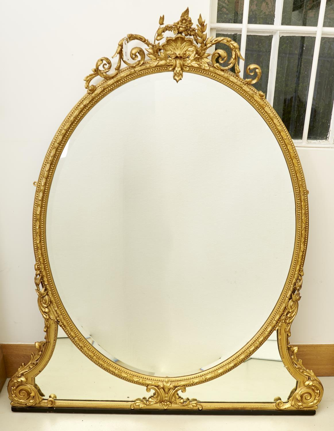 A VICTORIAN OVAL AND GILTWOOD COMPOSITION OVERMANTLE MIRROR, C1870, THE BEVELLED PLATE IN LAUREL AND
