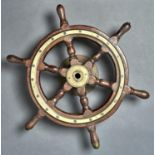 MARITIME ANTIQUES.  A VICTORIAN TEAK AND BRASS YACHT'S WHEEL, 51.5CM ACROSS HANDLES Showing signs of