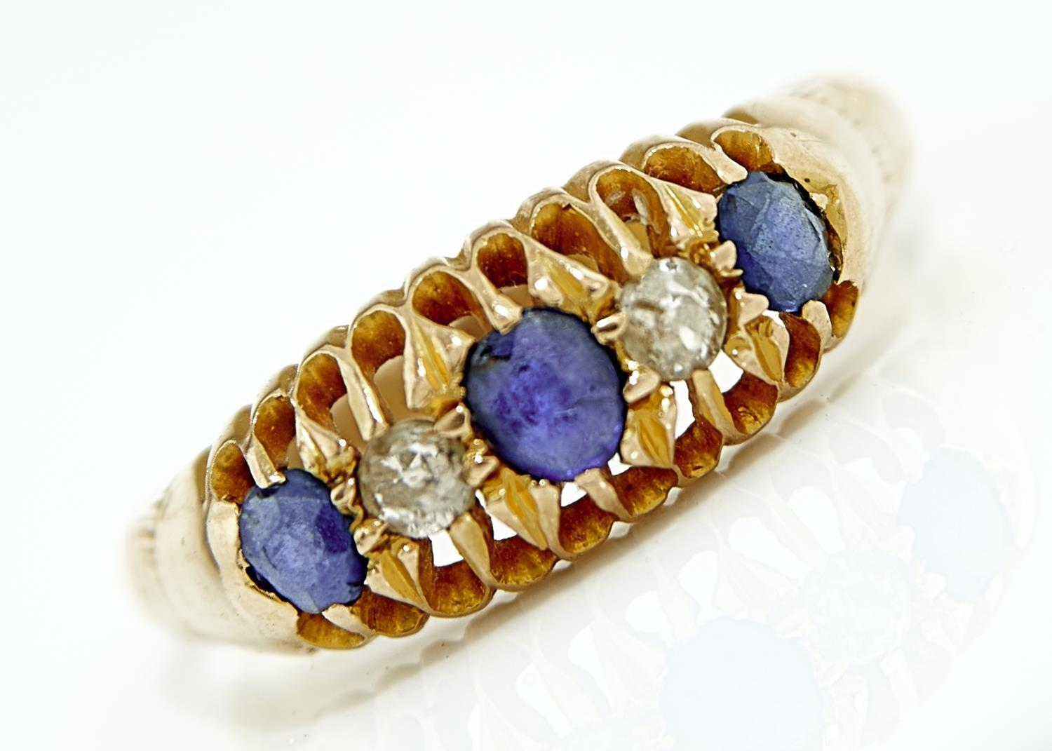 A FIVE STONE SAPPHIRE AND DIAMOND RING,  IN 18CT GOLD,  CHESTER 1911. 3.6G,  SIZE Q Stones