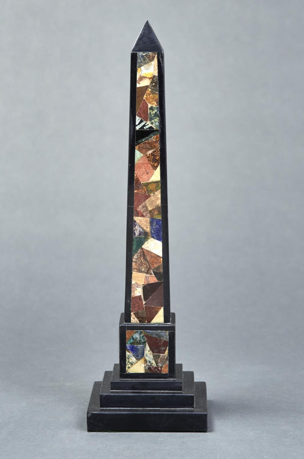 A VICTORIAN ASHFORD BLACK MARBLE AND COLOURED HARDSTONE OBELISK, LATE 19TH C, ON STEPPED SQUARE