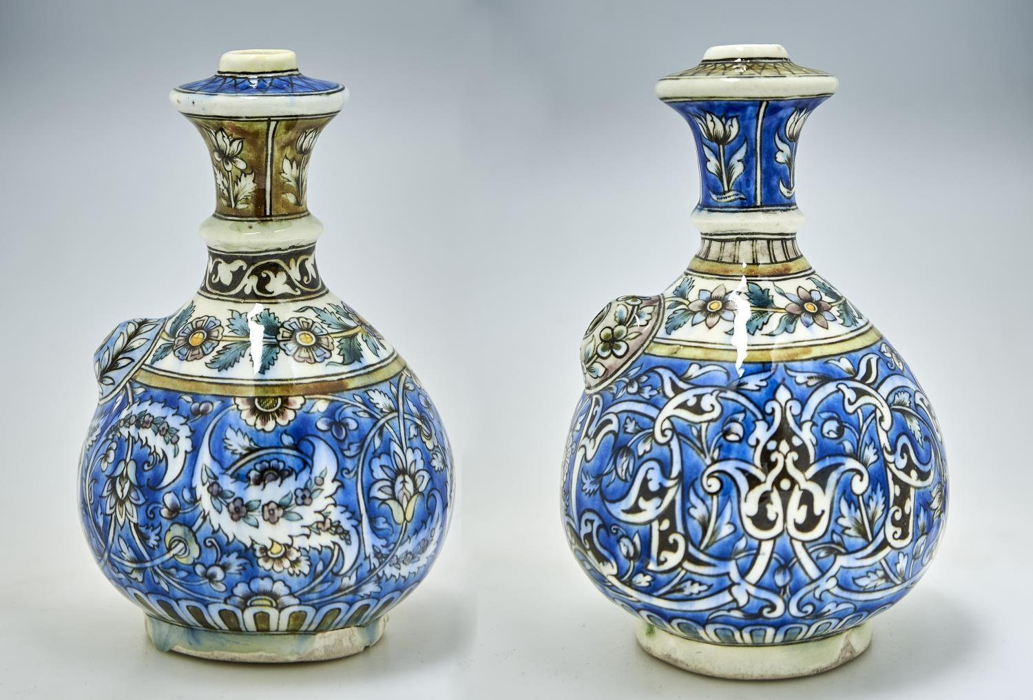 TWO ISLAMIC POTTERY KENDI, PROBABLY PERSIAN, LATE 19TH C OR LATER, OF FRIT PASTE OR SIMILAR AND OF
