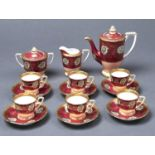 A NORITAKE CLARET GROUND COFFEE SERVICE, MID 20TH C, WITH GILT FLOWERS AND APRICOT LOWER BODY,