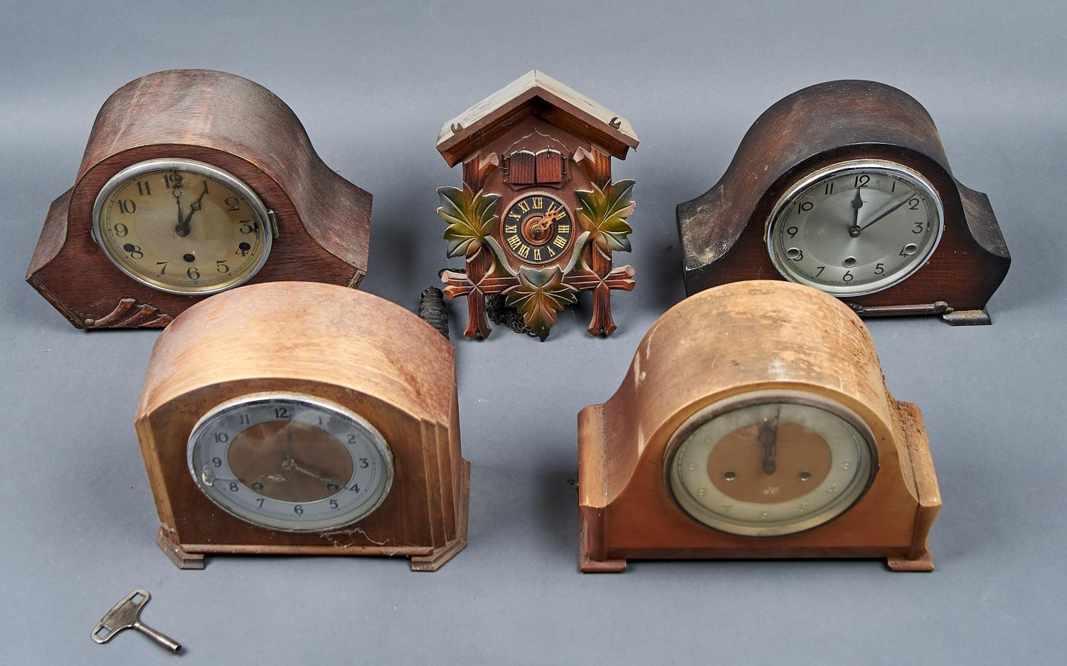FOUR MANTEL CLOCKS, ALL C1950, THREE WITH OAK VENEERED CASES, THE OTHER MAHOGANY, ALL WITH