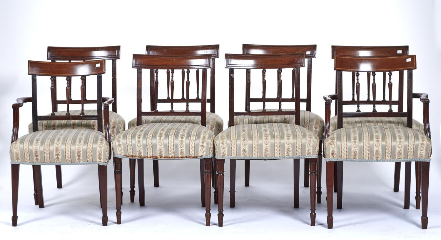 A SET OF SEVEN MAHOGANY SHERATON STYLE DINING CHAIRS, LATE 19TH / EARLY 20TH C, THE PANELLED CONCAVE